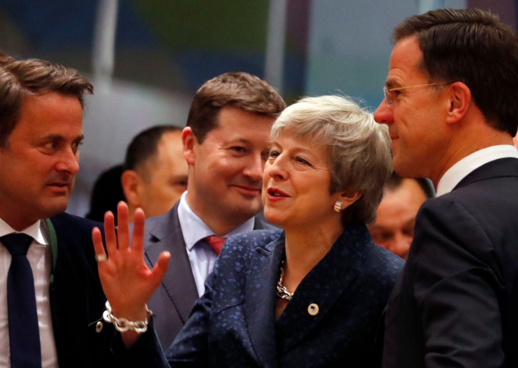 British Prime Minister Theresa May, center, speaks with Dutch Prime Minister Mark Rutte, right, and Luxembourg's Prime Minister Xavier Bettel, left, during a round table meeting at an EU summit in Brussels, . British Prime Minister Theresa May is trying to persuade European Union leaders to delay Brexit by up to three months, just eight days before Britain is scheduled to leave the blocEU Brexit, Brussels, Belgium - 21 Mar 2019