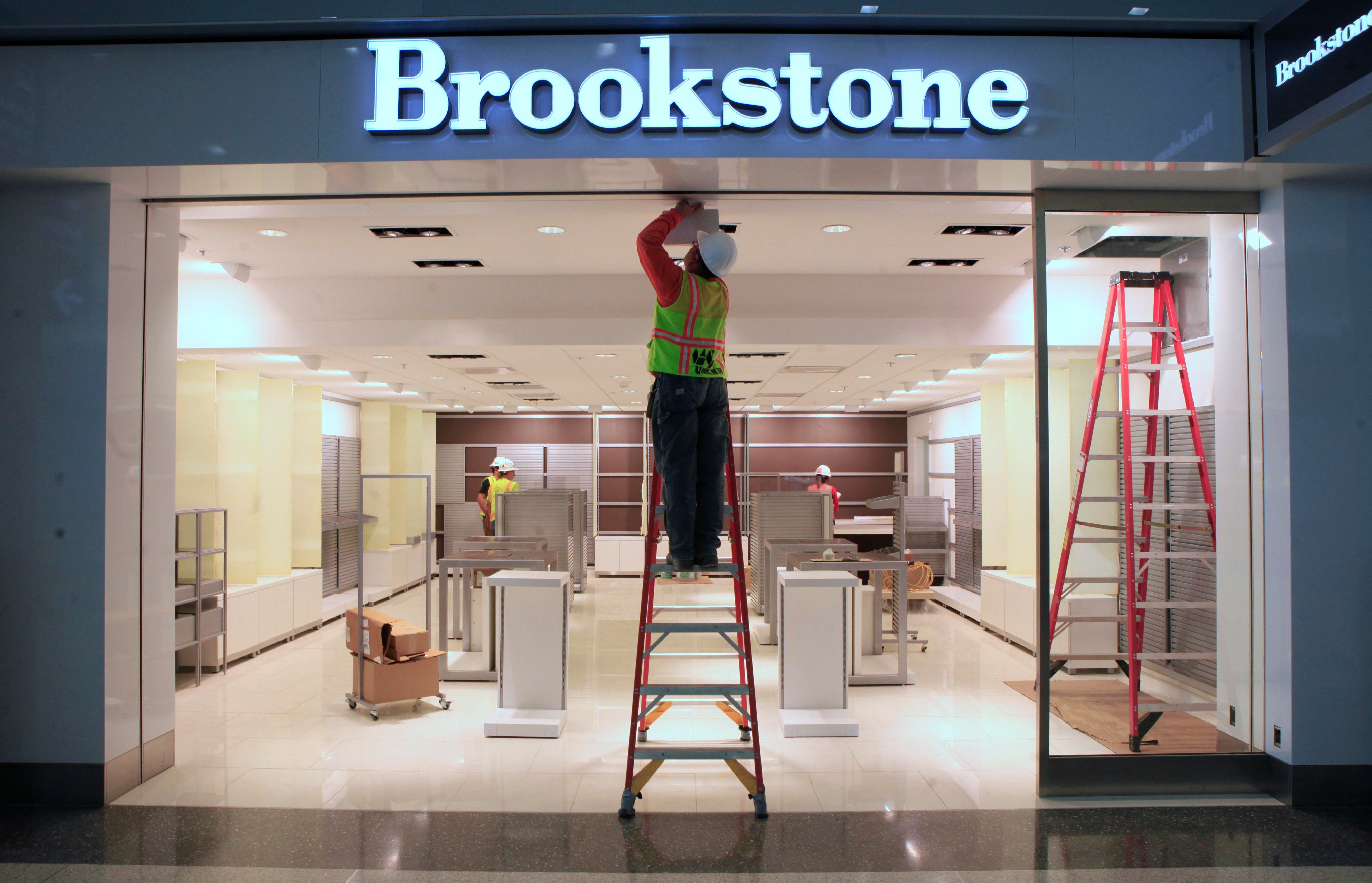 Work is done on a light fixture at the Brookstone shop at the new Terminal B at the Sacramento International Airport in Sacramento, Calif. The new $1 billion terminal, which is scheduled to open Thursday, Oct. 6, 2011 created 2,400 jobs during the 2 1/2 year construction project that officials say is the largest in Sacramento County's history, and is designed to expand the airport's capacity to 16 million passengers a yearSacramento Airport New Terminal, Sacramento, USA