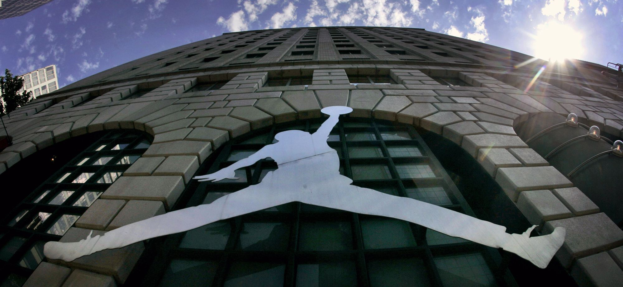 """A Michael Jordan logo reflects off of Niketown in Portland, Ore. A photographer has accused Nike of violating the copyright of his 1984 image of a soaring Michael Jordan, which he alleges the company later misused to create the profitable """"Jumpman Logo."""" The lawsuit, filed in federal court in Portland,, seeks unspecified monetary damages based on profits attributable to the infringement on the copyrightNike Lawsuit-Jordan Copyright, Portland, USA"""