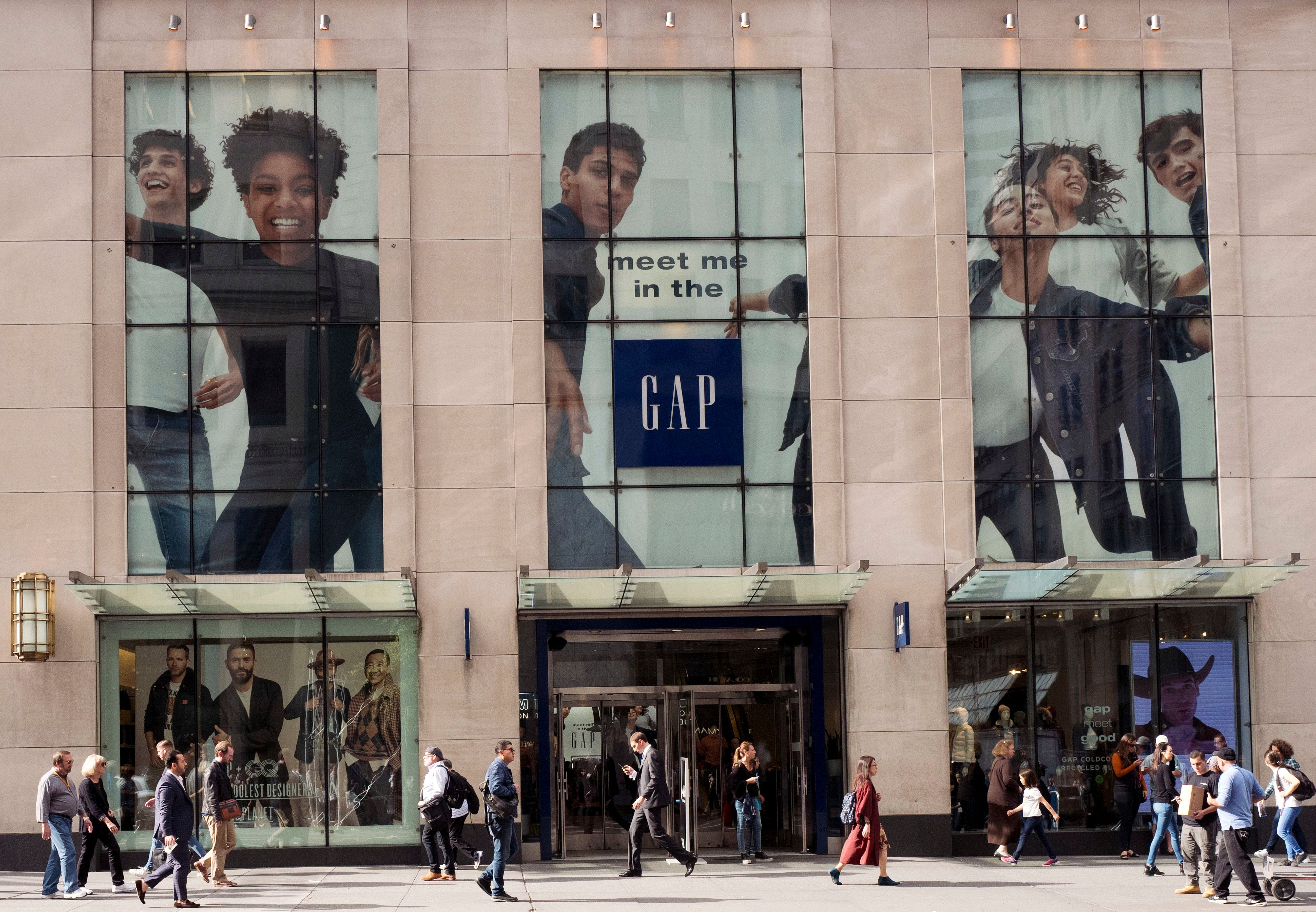 People walk by the advertising for a Gap store on New York's Fifth Avenue. Diversity in the advertising industry is becoming a higher priority for consumer product companies as they try to reach a new generation of customers with evolving sensibilities on ethnicity, age, gender and sexualityDiverse Advertising-Getting it Right, New York, USA - 23 Oct 2017
