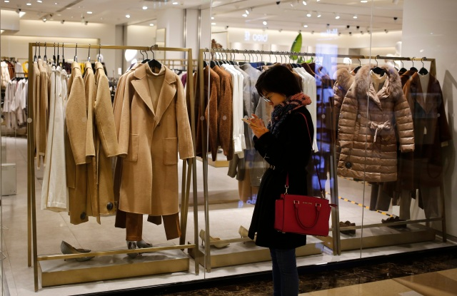 A Chinese consumer walks in a shopping mall in Beijing, China, 16 November 2018. China's consumer price index (CPI), a main gauge of inflation, rose 2.5 percent year-on-year in October, according to the National Bureau of Statistics (NBS).China economy consumption, Beijing - 16 Nov 2018