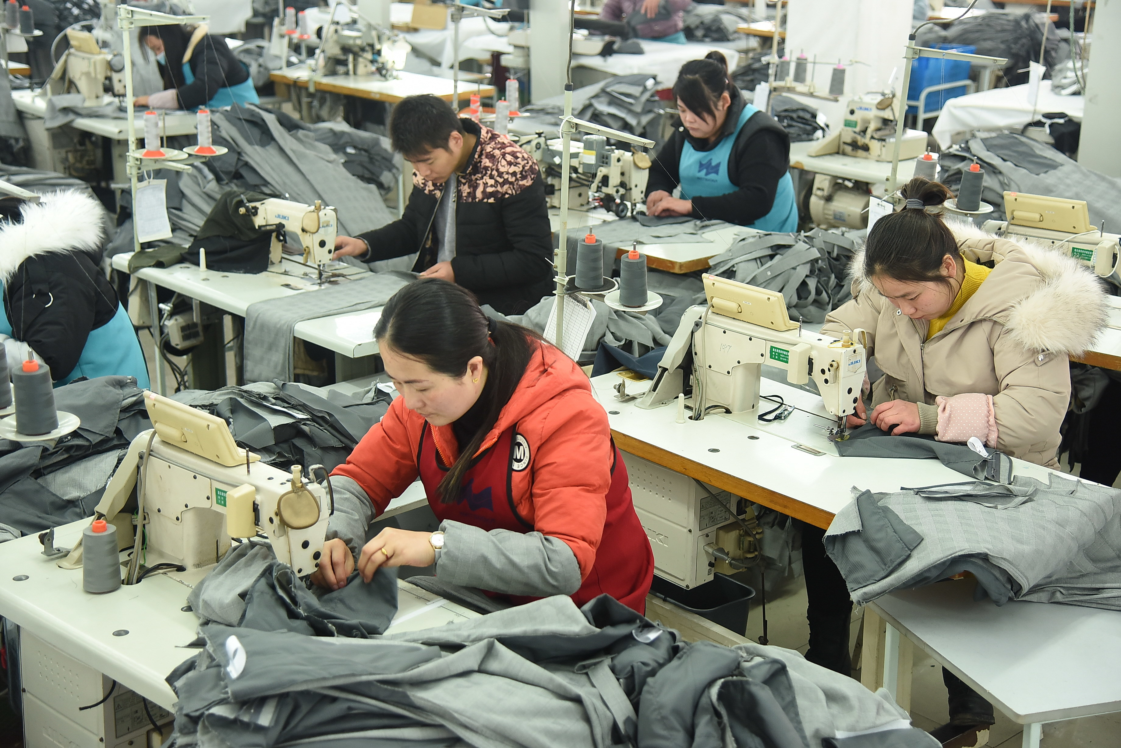 Workers at a clothes manufacturing factory in Lianyungang, Jiangsu ProvinceWorkers at a clothes manufacturing factory, China - 13 Feb 2019