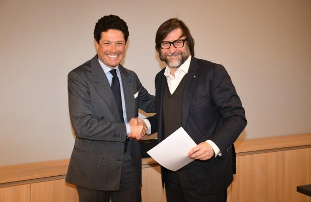 Matteo Marzotto, president of Mittelmoda International Lab and Confindustria Moda president Claudio Marenzi sign partnership.