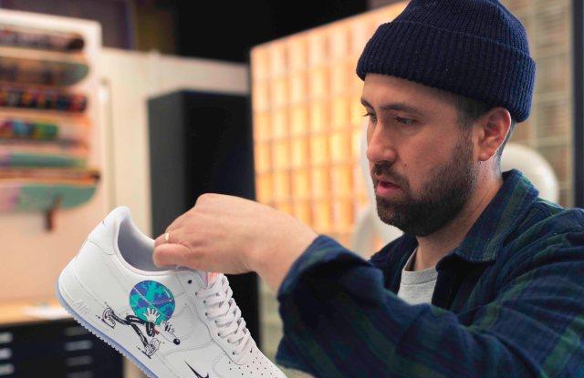 Artist Steven Harrington working on his Nike Earth Day caspule.