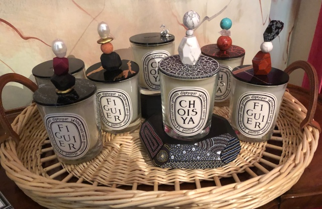 Diptyque candles and decorative lids by Jean Baptiste Mayet.