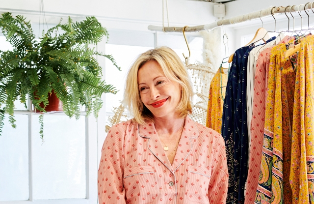Lubov Azria in front of a rack of her La Boheme clothing.