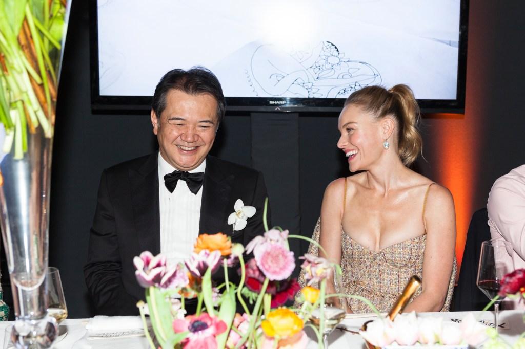 Kosé Corporation's president and CEO Kazutoshi Kobayashi and Kate Bosworth.
