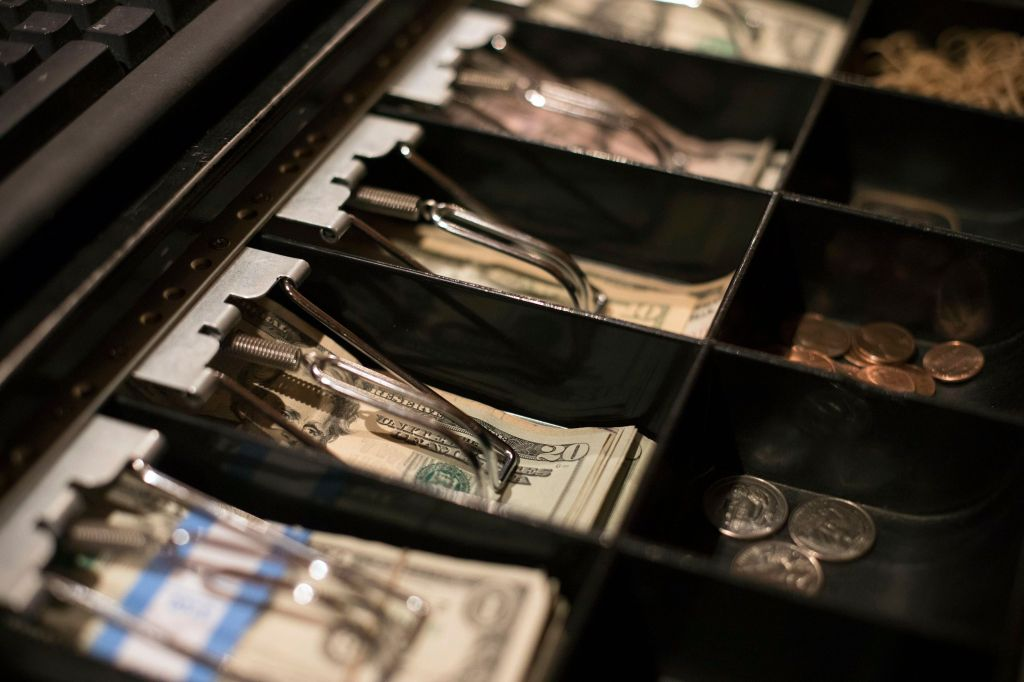 This, photo shows twenty dollar bills in a register at a business in Eagle, Colo. While many business owners know they'll owe the government less money or perhaps get refunds under the new tax law, others are still unsure about what they might have to pay while they file their returns. They need to be sure they have some extra cash, or access to financing, in case they're facing sizeable tax billsSmallBiz Get Started, Eagle, USA - 25 Dec 2018
