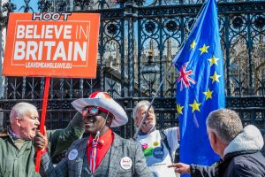 Rivals argue about their 'pitch' outside the gates of Parliament - Leave means leave and SODEM, pro EU, protestors continue to make their points, side by side, outside Parliament as MP's appear to make little progress on a deal.Pro and anti Brexit protests, London, UK - 01 Apr 2019