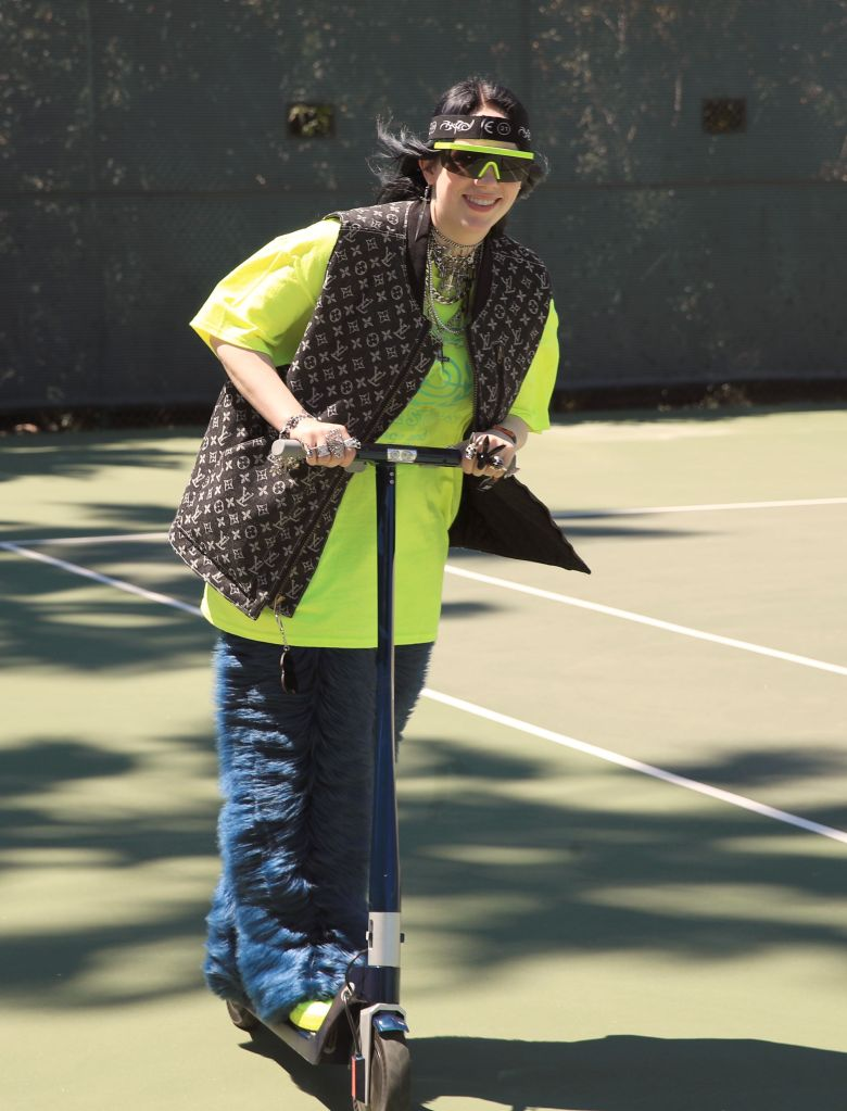 Billie Eilish rides a scooter on the tennis court at the 5th annual Interscope Coachella party.The 5th Annual Interscope Coachella Party, Coachella Valley Music and Arts Festival, Weekend 1, Day 2, Palm Springs, USA - 13 Apr 2019