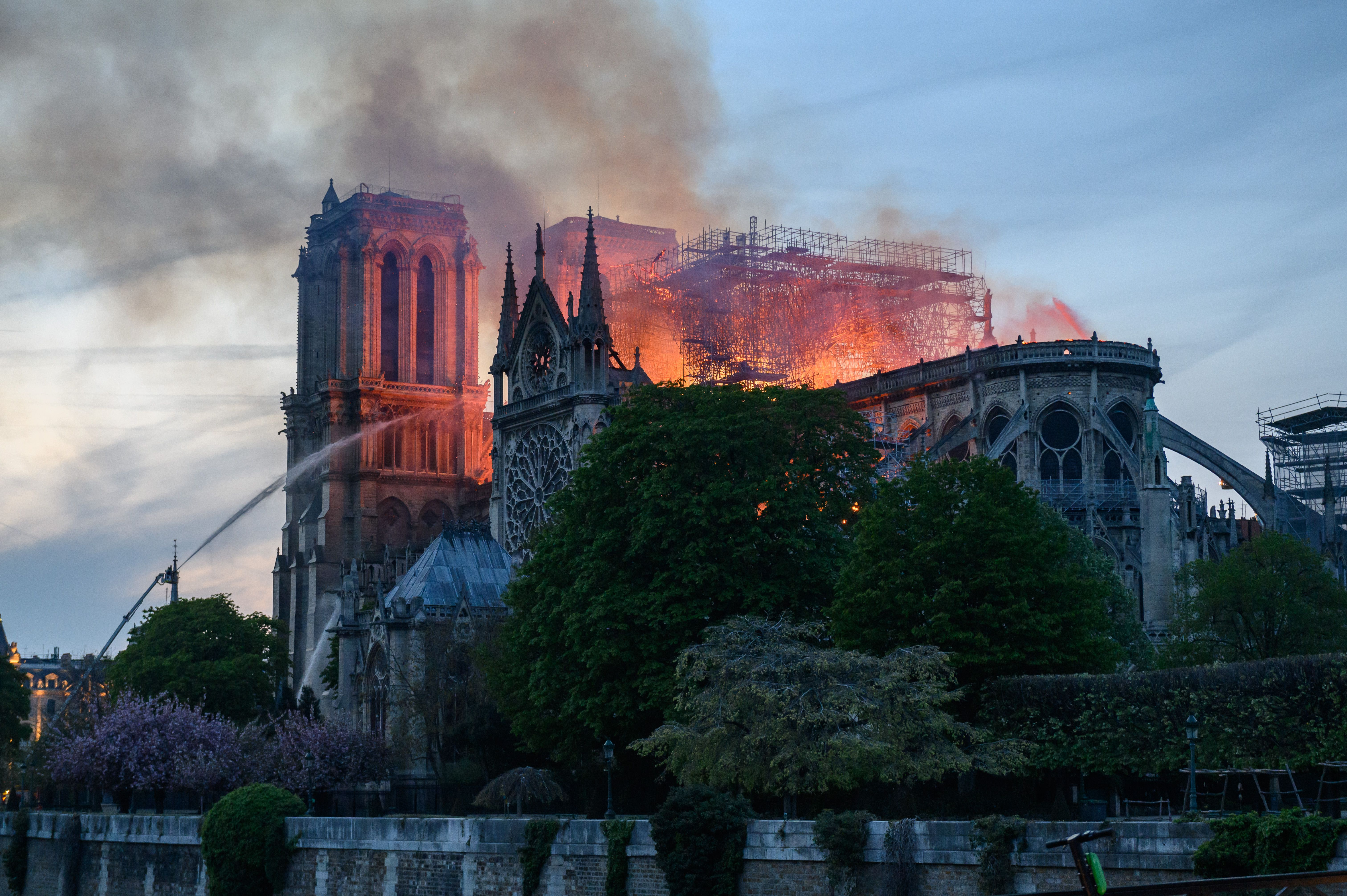 Flames rise from Notre Dame cathedral as it burns.Notre-Dame Cathedral Fire, Paris, France - 15 Apr 2019