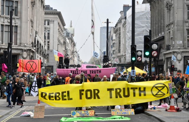 Protesters from the Extinction Rebellion campaign group block Oxford Circus in central London, Britain, 16 April 2019. The Extinction Rebellion are holding a number of protests across London to draw attention to climate change.Climate Change protests across London, United Kingdom - 16 Apr 2019