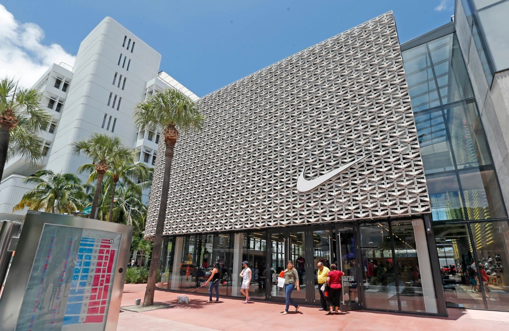 Shoppers walk out of a Nike store in Miami Beach, Fla. Nike Inc. reports earnings, Tuesday, Sept. 26, 2017Earns Nike, Miami Beach, USA - 08 Aug 2017