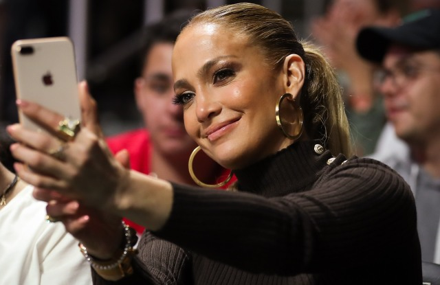 American singer and actress, Jennifer Lopez, also known by her nickname J.Lo, takes a selfie during the second half of the NCAA men's basketball game between the Duke Blue Devils and the University of Miami Hurricanes at the Watsco Center in Coral Gables, Florida. Duke won 83-75NCAA Basketball Duke vs Miami, Coral Gables, USA - 15 Jan 2018