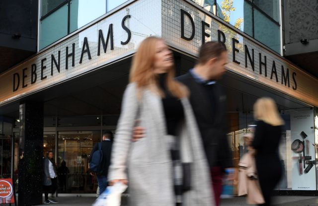 Pedestrians pass a Debenhams store in Oxford Street in London, Britain, 25 October 2018. According to news reports Debenhams has confirmed plans to shut fifty of it stores across the UK. Some 5,000 jobs may be at risk.Debenhams confirms plans to shut up to 50 stores, London, United Kingdom - 25 Oct 2018