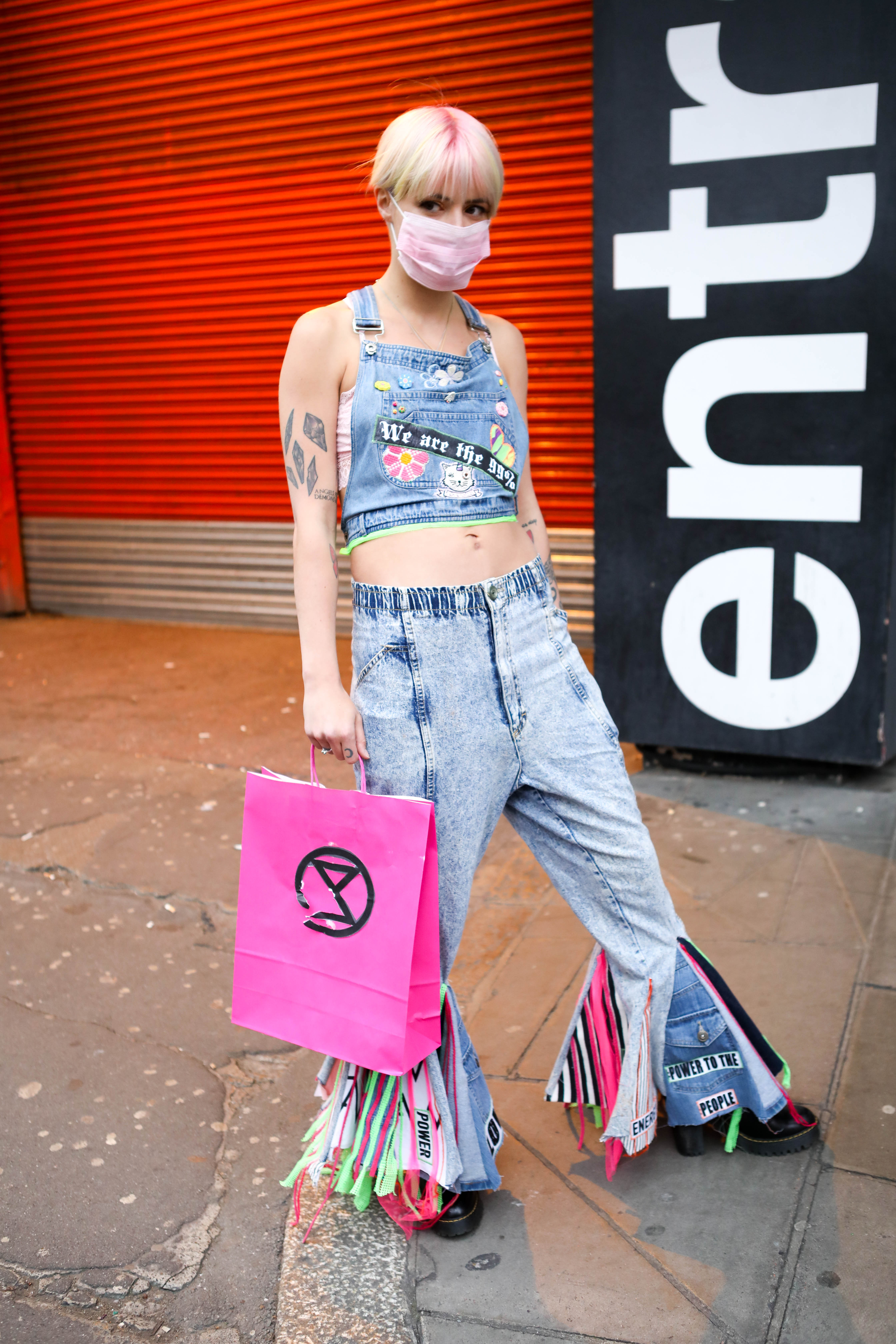 Environmental campaign group Extinction Rebellion hold a fashion show on Oxford Circus to highlight issues of un-sustainability in fashion and how its practices impact on the environment.Extinction Rebellion fashion show, London, UK - 12 Apr 2019