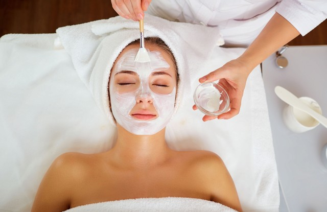 Woman in mask on face in spa salon.; Shutterstock ID 788986801