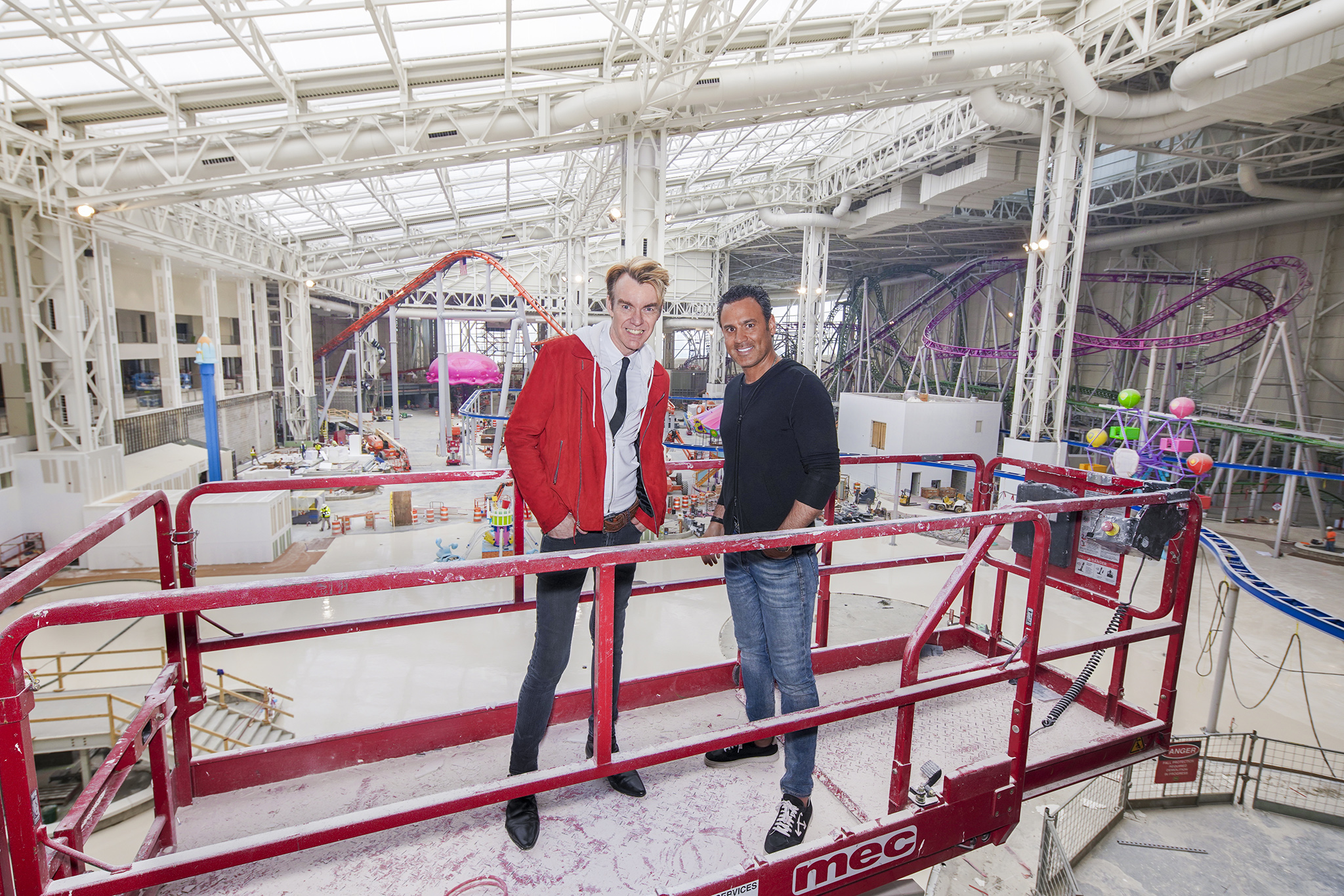 Ken Downing and Don Ghermezian with American Dream's Nickelodeon Universe Theme Park in the background.