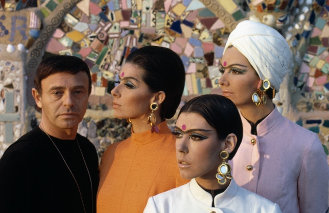 Rudi Gernreich with models wearing his designs in front of Watts Towers, 1965.