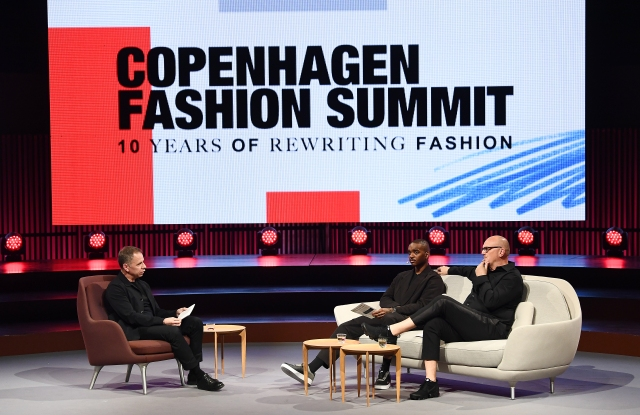 Miles Socha, Editor in Chief, WWD, Samuel Ross, Founder and Designer, A-Cold-Wall, and John Hoke, Chief Design Officer, Nike, in a panel discussion at Copenhagen Fashion Summit
