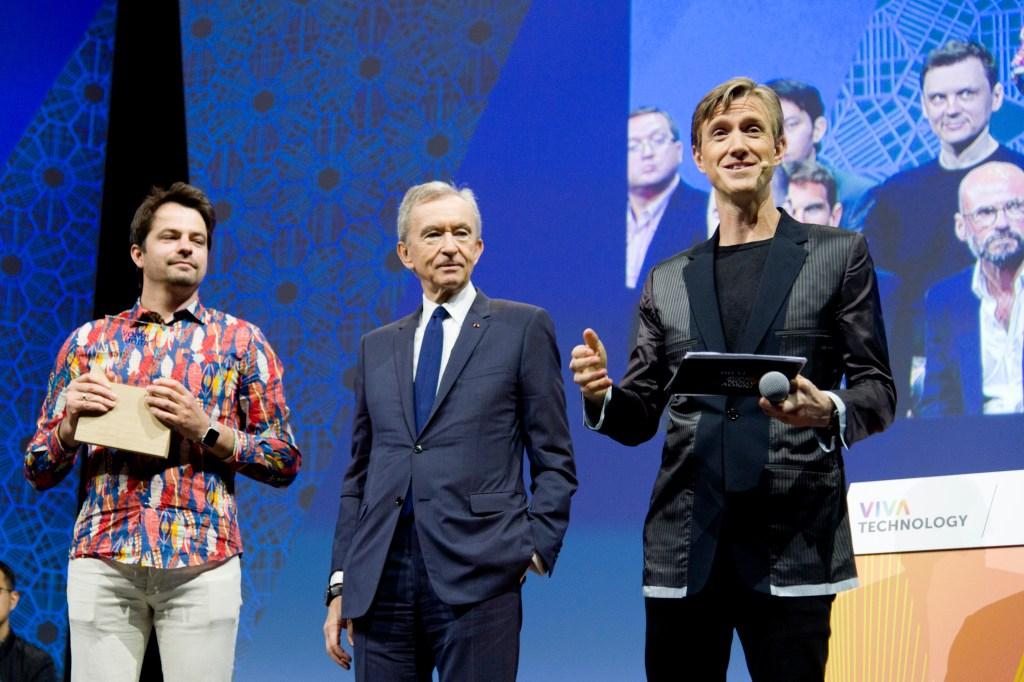 Vadim Rogovskiy, winner of the LVMH Innovation Award, with Bernard Arnault and Ian Rogers.