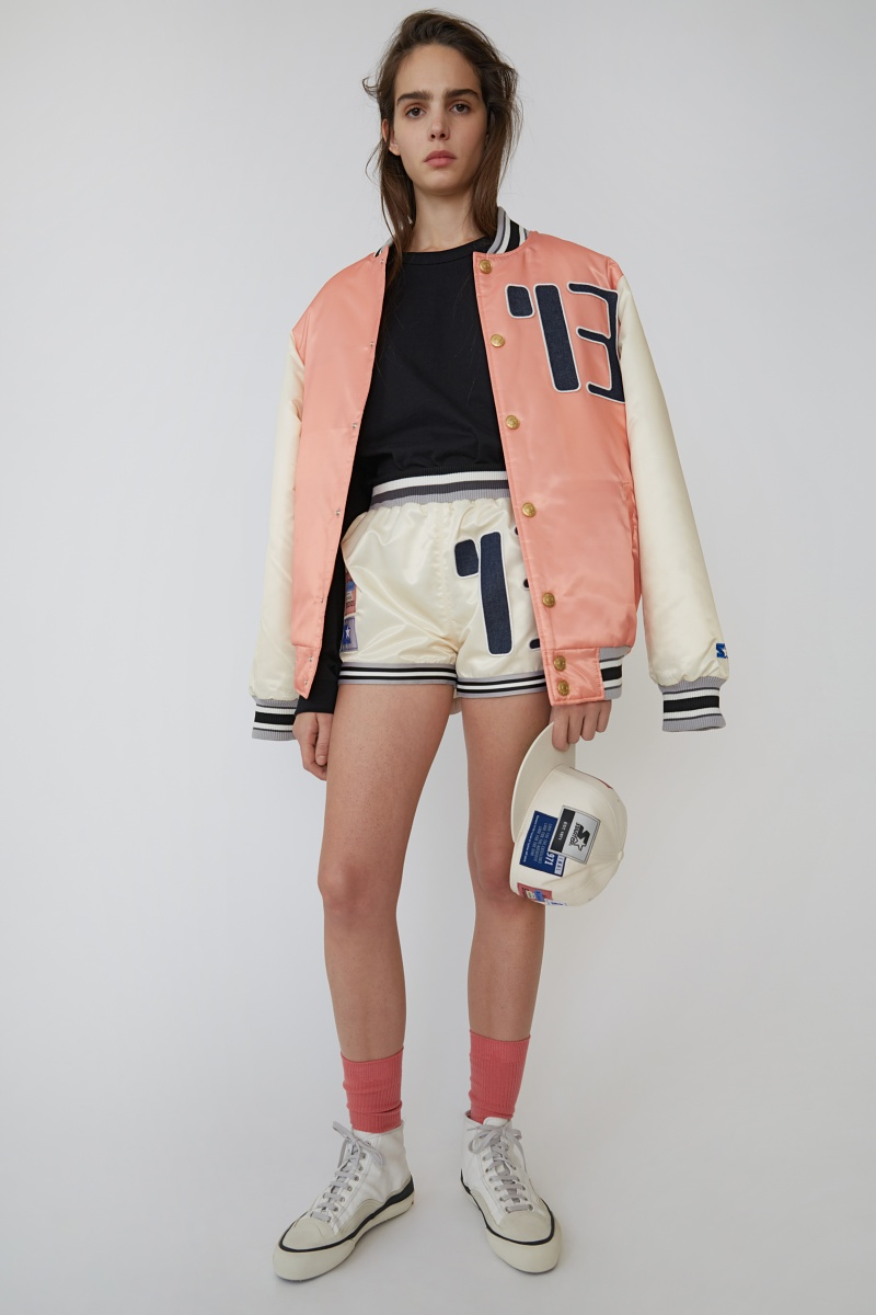 The Acne Studios x Starter Black Label line includes a pink and white version of the signature Starter baseball jacket.