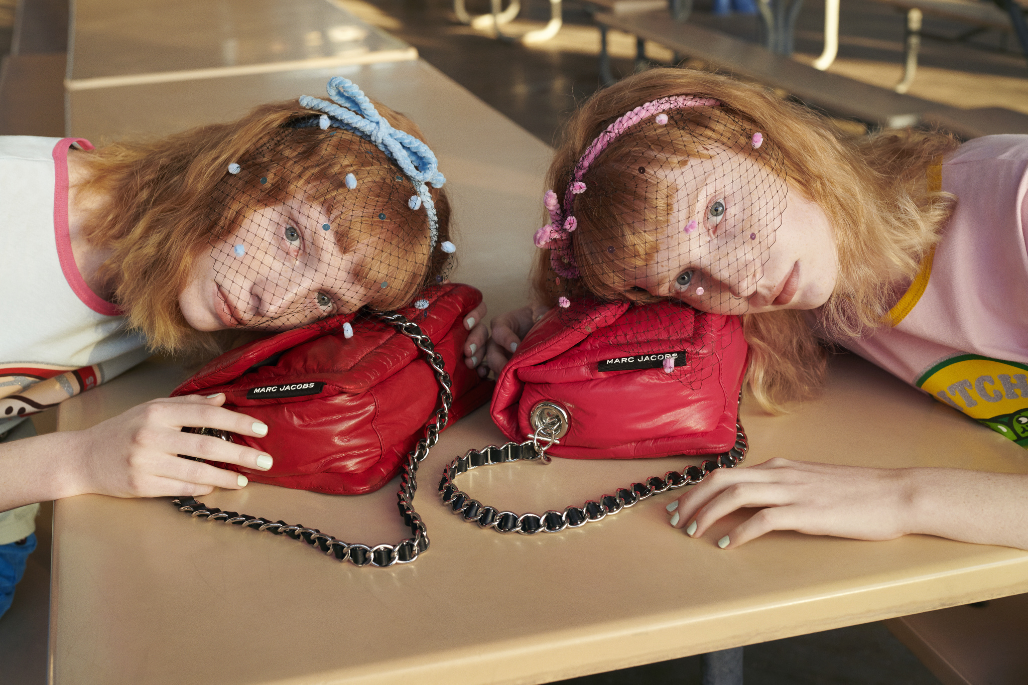 THE Marc Jacobs is all about pieces to wear as one wishes. Or two. Shot by Hugo Scott and styled by Lotta Volkova, the inaugural campaign features a diverse roster of twins doing their twin thing  with style. but each very different. Here, Grace and Hope Fly work THE Ringer T-shirts and pillow bags and Stephen Jones Marc Jacobs headbands.