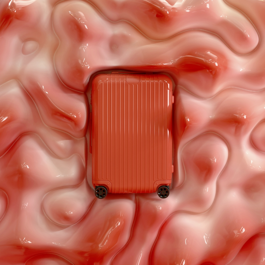 A coral polycarbonate suitcase from the new Rimowa Essential collection.