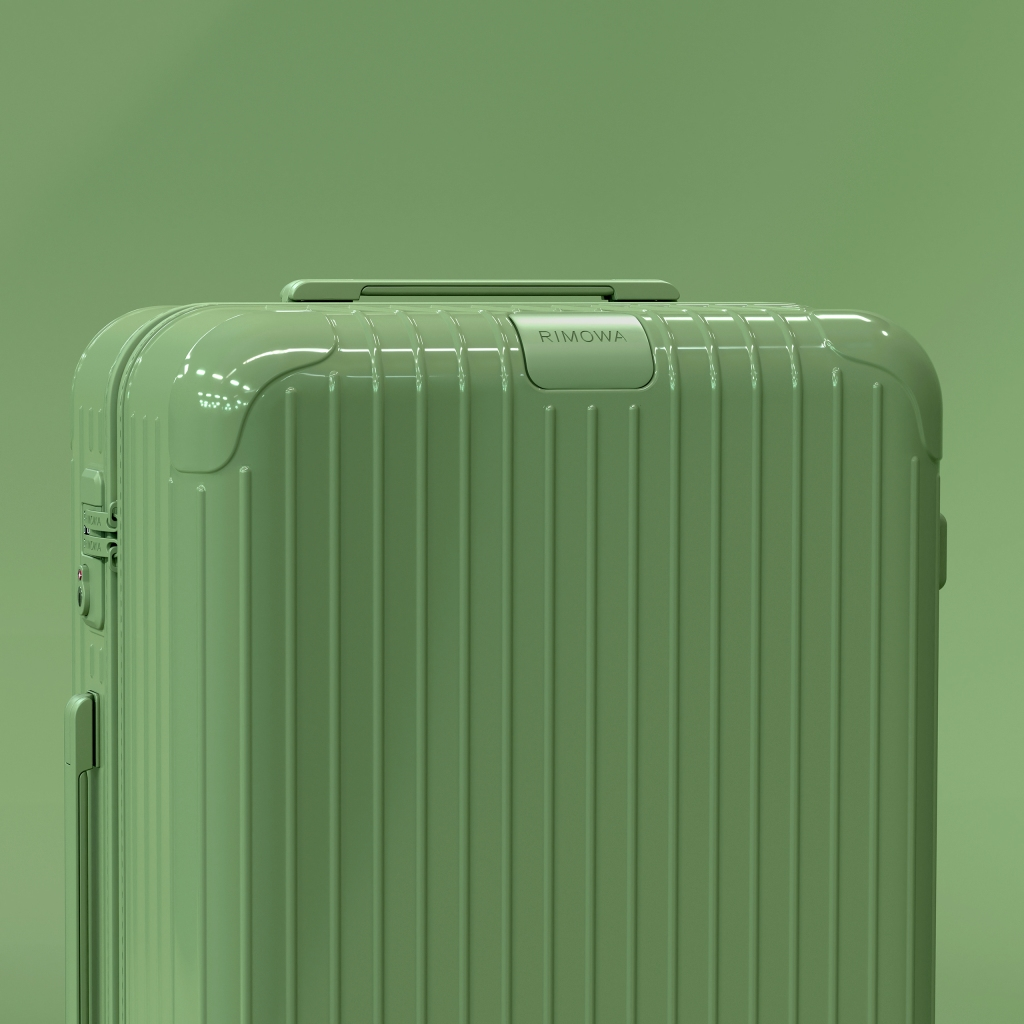 A sage polycarbonate suitcase from the new Rimowa Essential collection.