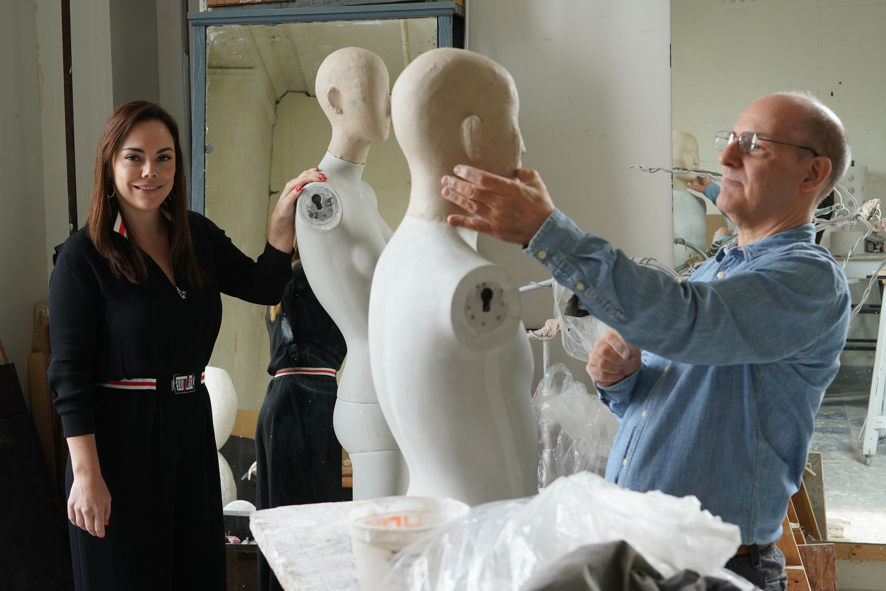 Master sculptor Michael Evert and Lourdes Mendez at the Pucci mannequin factory.