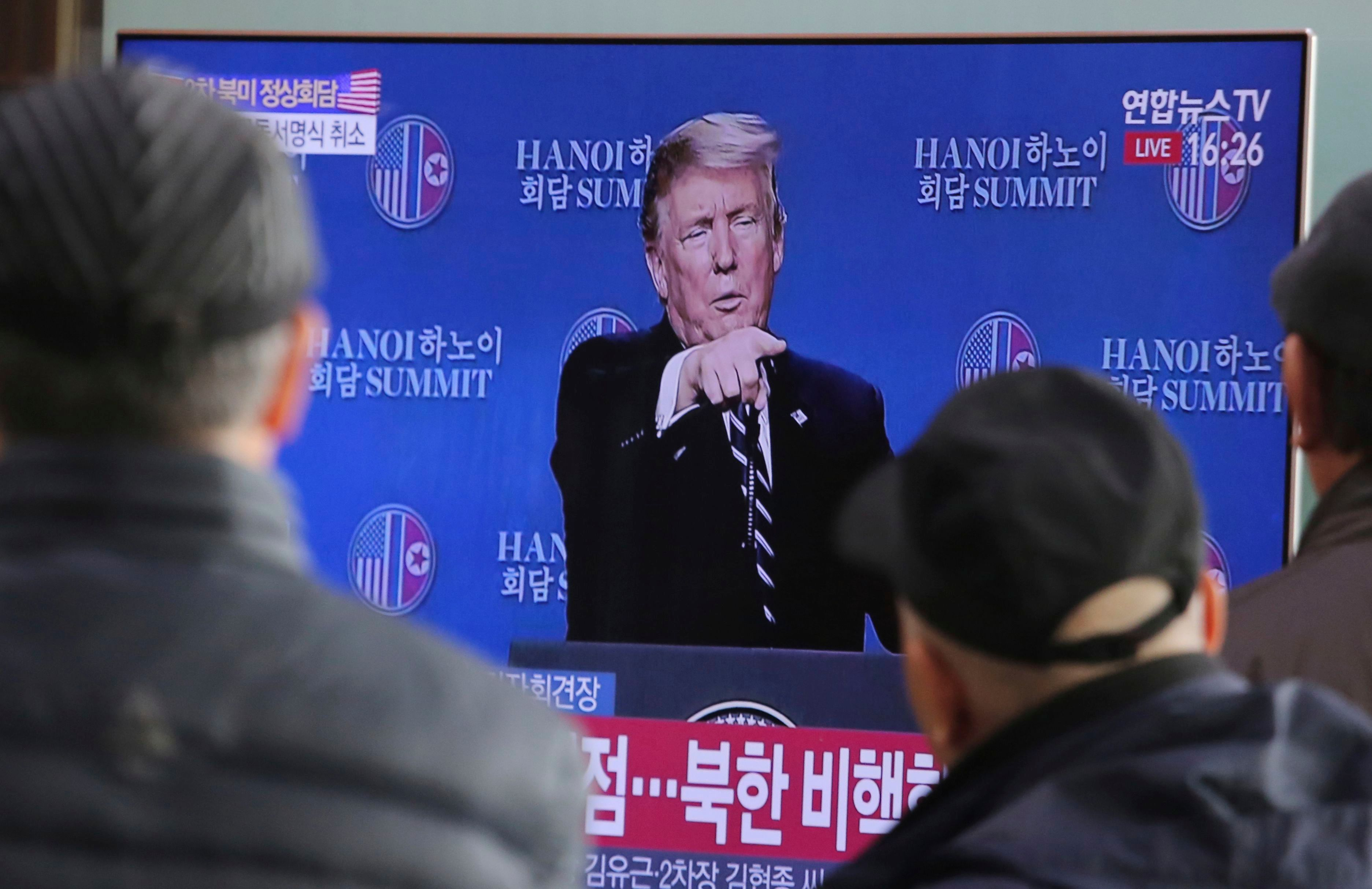 "People watch a TV screen showing U.S. President Donald Trump's press conference during a news program at the Seoul Railway Station in Seoul, South Korea, . The nuclear summit between President Donald Trump and North Korea's Kim Jong Un collapsed Thursday after the two sides failed to reach a deal due to a standoff over U.S. sanctions on the reclusive nation, a stunning end to high-stakes meetings meant to disarm a global threat. The signs read: "" DenuclearizationTrump Kim Summit, Seoul, South Korea - 28 Feb 2019"