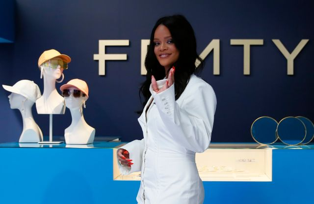 Rihanna poses as she unveils her first fashion designs for Fenty at a pop-up store in Paris, France.