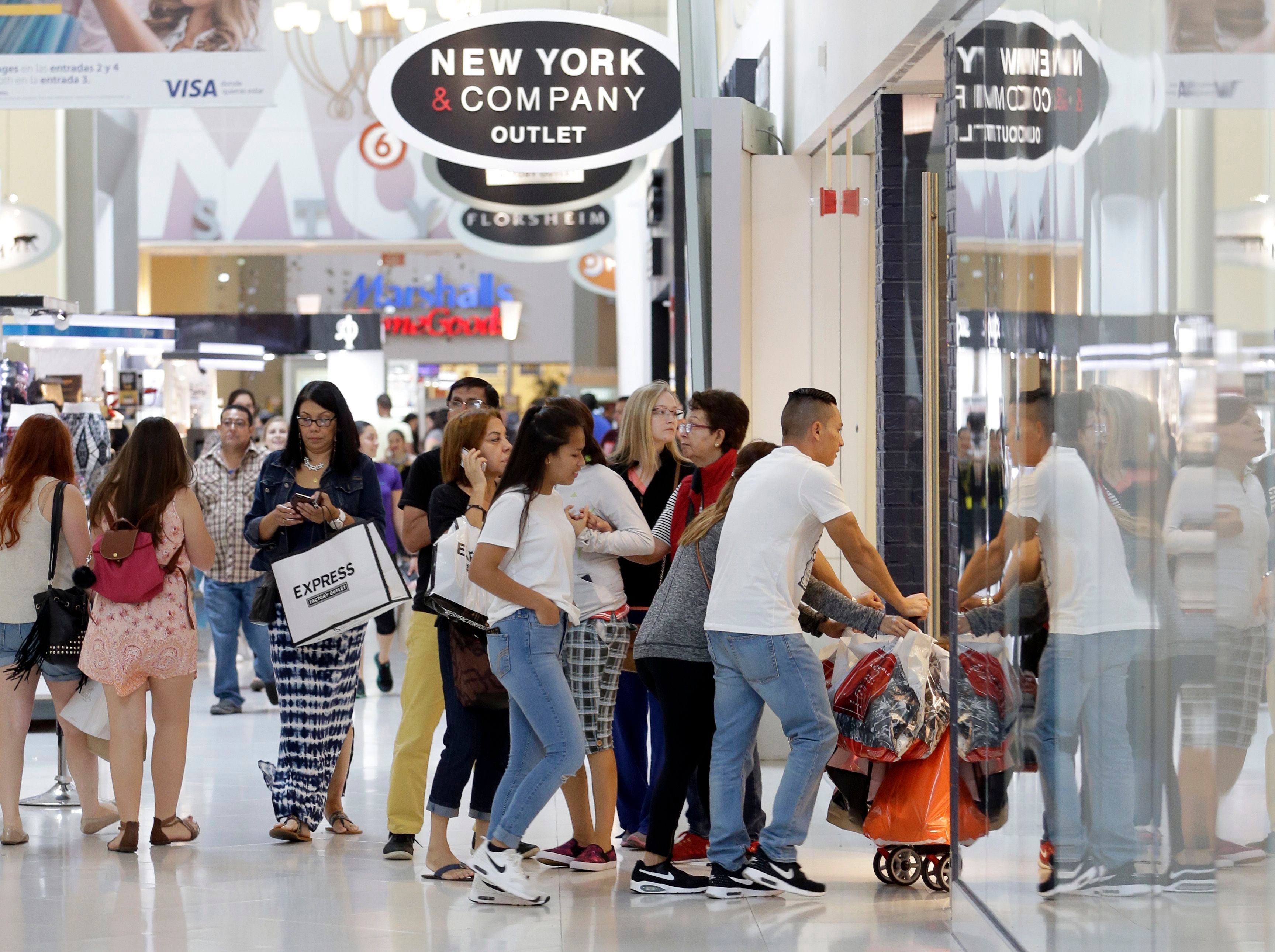 Shoppers shop at the Dolphin Mall on Black, in Miami. Stores open their doors Friday for what is still one of the busiest days of the year, even as the start of the holiday season edges ever earlierHoliday Shopping Black Friday, Miami, USA - 25 Nov 2016