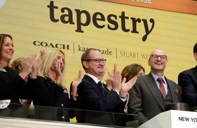 Tapestry Inc. CEO Victor Luis, right, home to Coach, Kate Spade and Stuart Weitzman brands, is applauded as he rings the New York Stock Exchange opening bellFinancial Markets Wall Street, New York, USA - 31 Oct 2017
