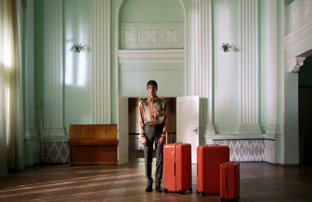 A campaign image for Rimowa's new range of colored suitcases