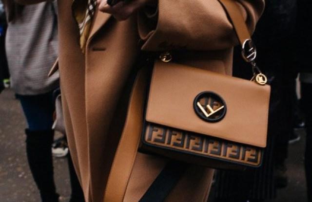 Farfetch introduces handbag resale service.