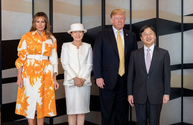 In this photo provided by the Imperial Household Agency of Japan, Japanese Emperor Naruhito, right, and U.S. President Donald Trump, second from right, flanked by Empress Masako, right, and First lady Melania Trump, left, pose for a photo at a hotel in TokyoTrump, Tokyo, Japan - 28 May 2019