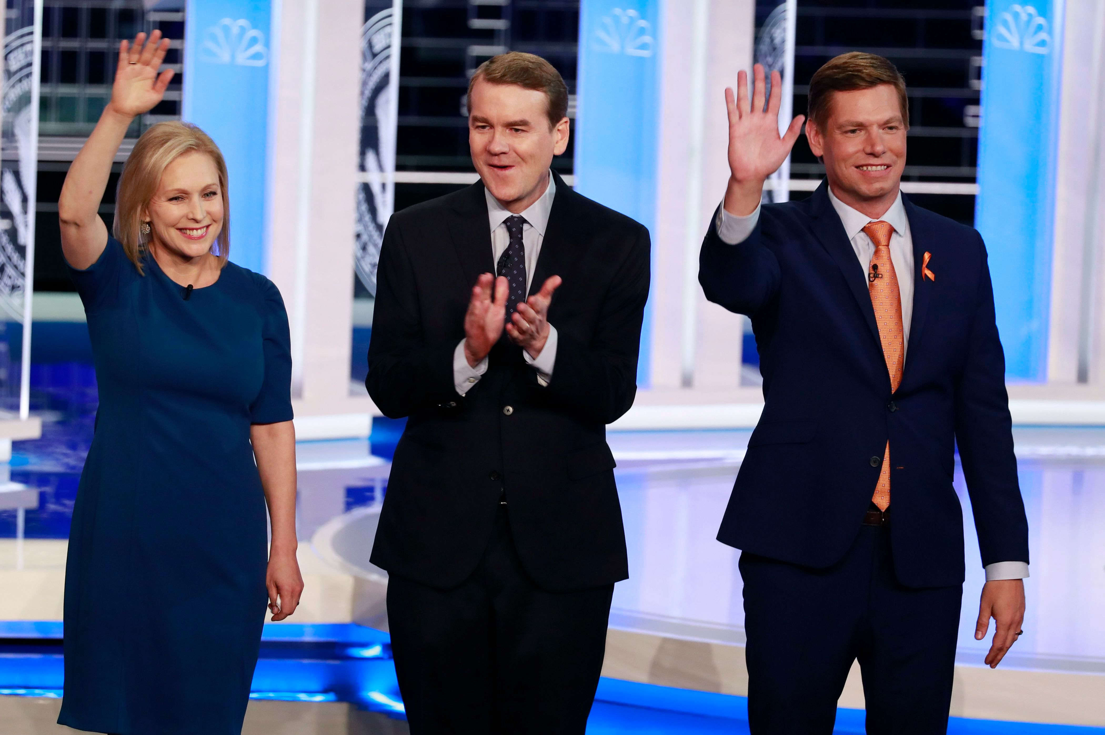 Democratic presidential candidates Sen. Kristen Gillibrand, D-N.Y., left, former Colorado Sen. Michael Bennet and Rep. Eric Swalwell, D-Calif., stand on stage before a Democratic primary debate hosted by NBC News at the Adrienne Arsht Center for the Performing Arts, in MiamiDem 2020 Debate, Miami, USA - 27 Jun 2019