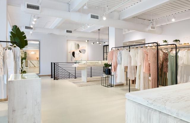 Atlerie's expanded space is lightened with materials such as the marble-like Figured Maple – Stone White.