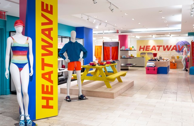 The Heatwave installation at Barneys New York's Madison Avenue flagship, with Onia's rainbow swimsuit in the foreground.