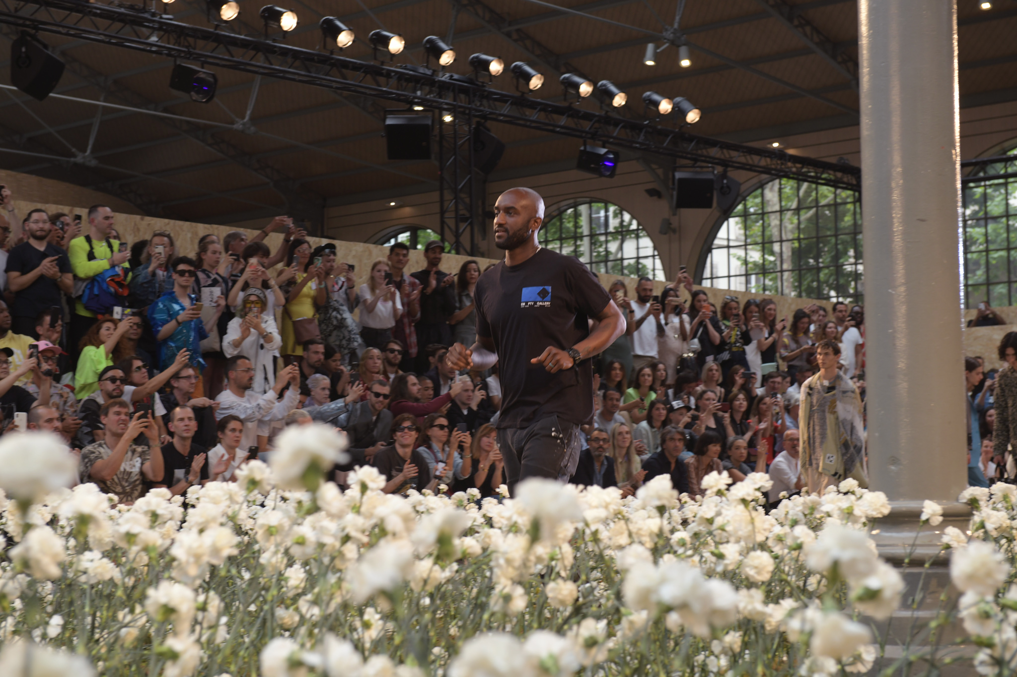 Virgil Abloh takes a bow after the Off White spring 2020 show