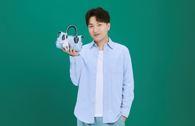 Tao Liang with the new unicorn handbag