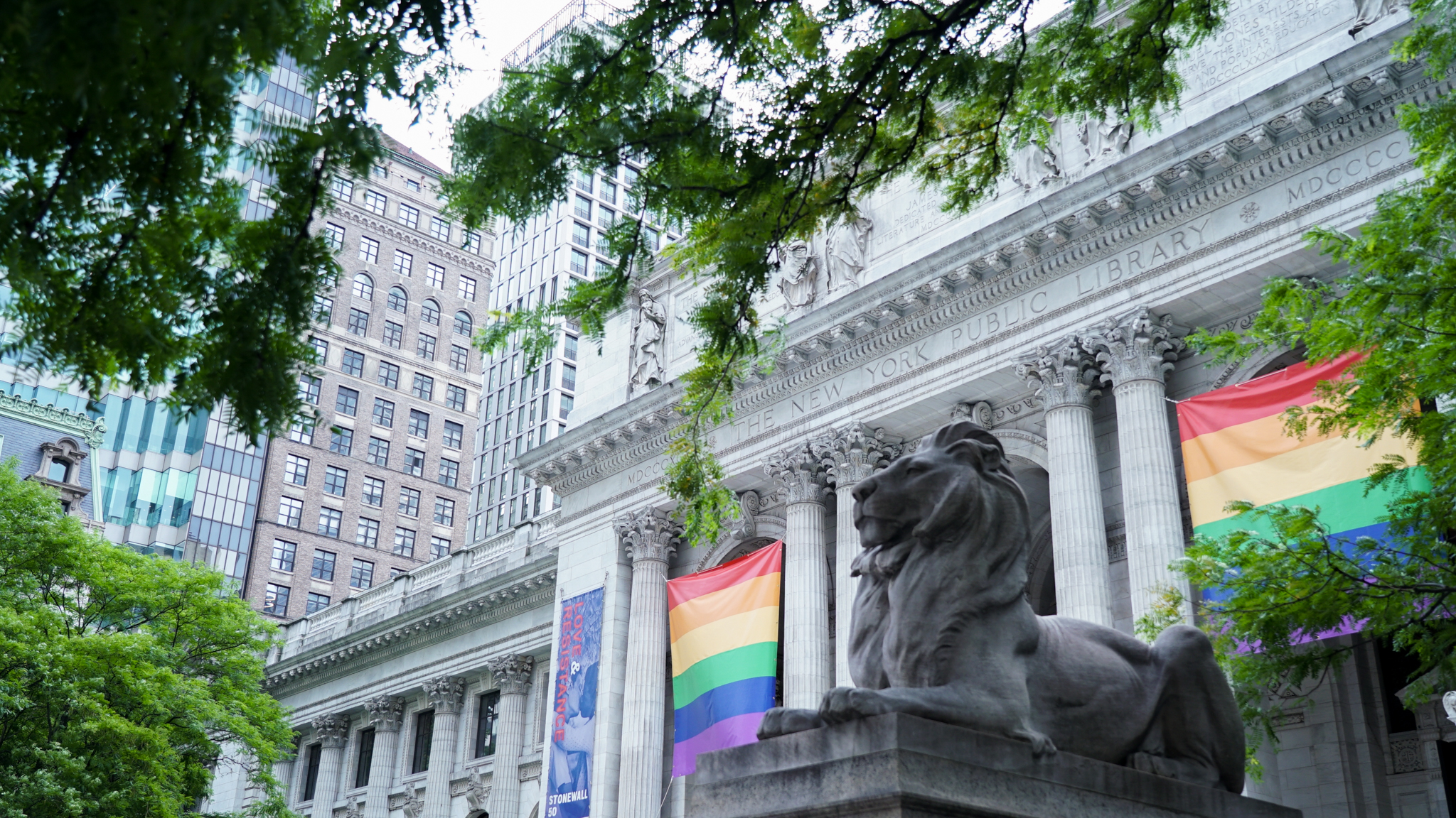 Banners on the front of the New York Public Library honoring Pride Month.
