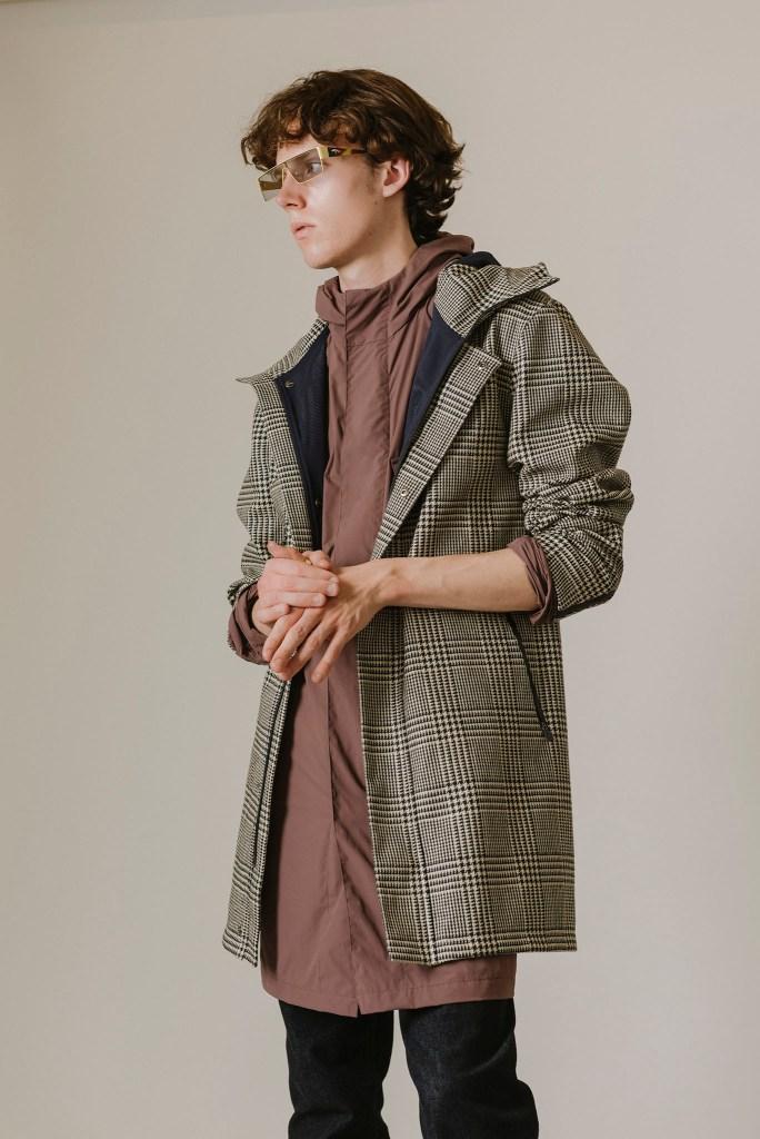 Herno's Laminar jacket over Herno's Globe jacket with Frame's denim pants.