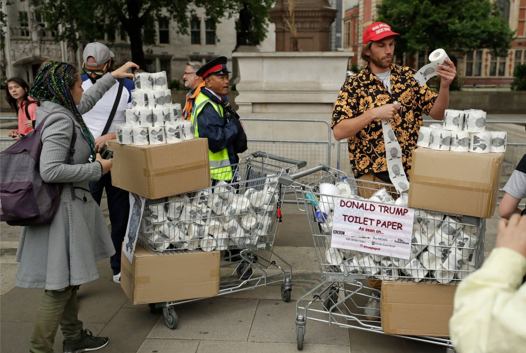 People hand out Donald Trump toilet paper in central London as people start to gather to demonstrate against the state visit of President Donald Trump, . Trump will turn from pageantry to policy Tuesday as he joins British Prime Minister Theresa May for a day of talks likely to highlight fresh uncertainty in the allies' storied relationshipTrump, London, United Kingdom - 04 Jun 2019