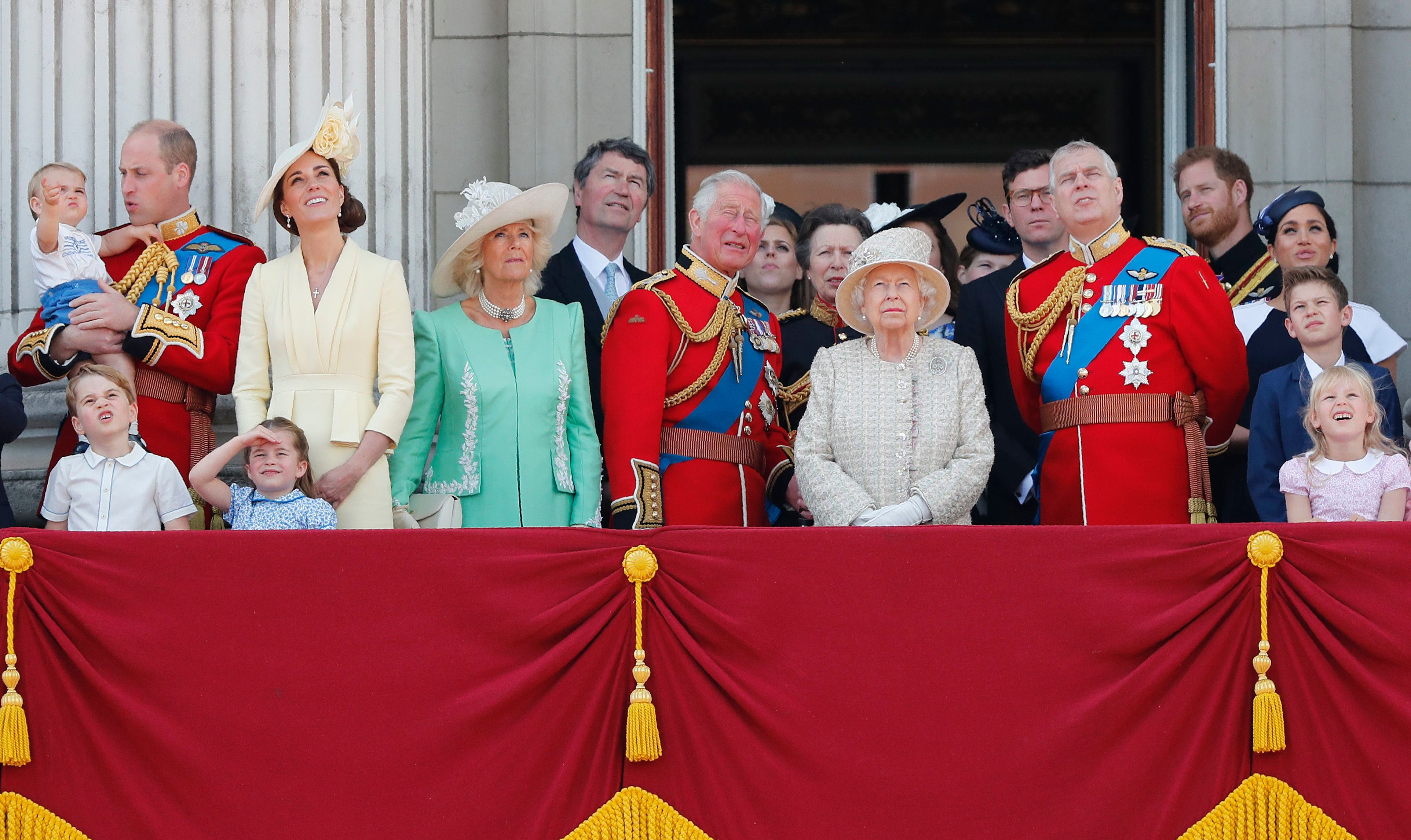 Britain's Queen Elizabeth, center, and members of the royal family attend the annual Trooping the Colour Ceremony in London