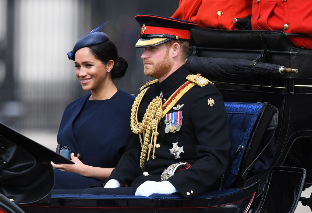 Harry and Meghan, Duke and Duchess of Sussex ride in a carriage during the Trooping of the Colour
