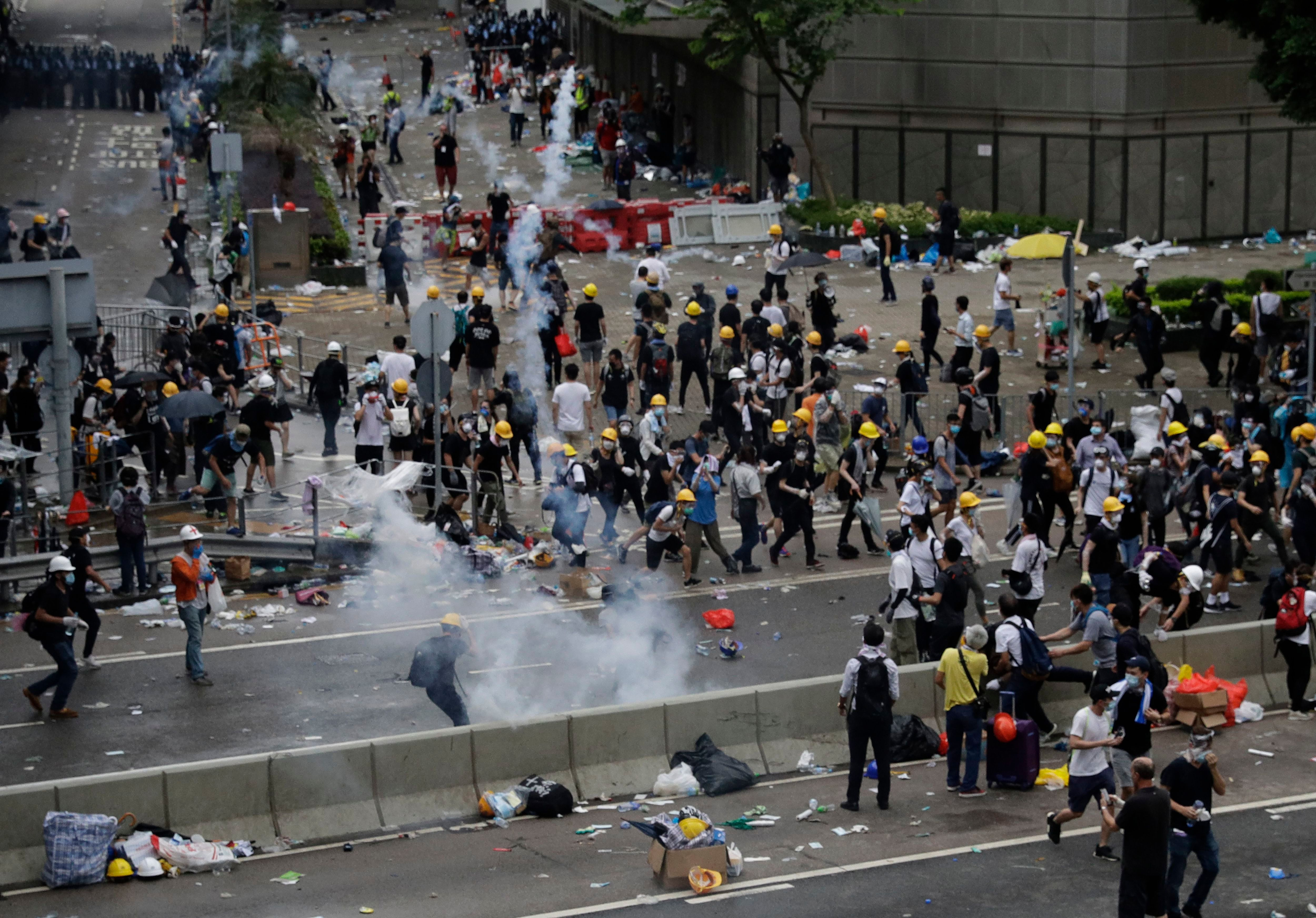 Hong Kong police fire tear gas at crowds protesting a proposed extradition bill.