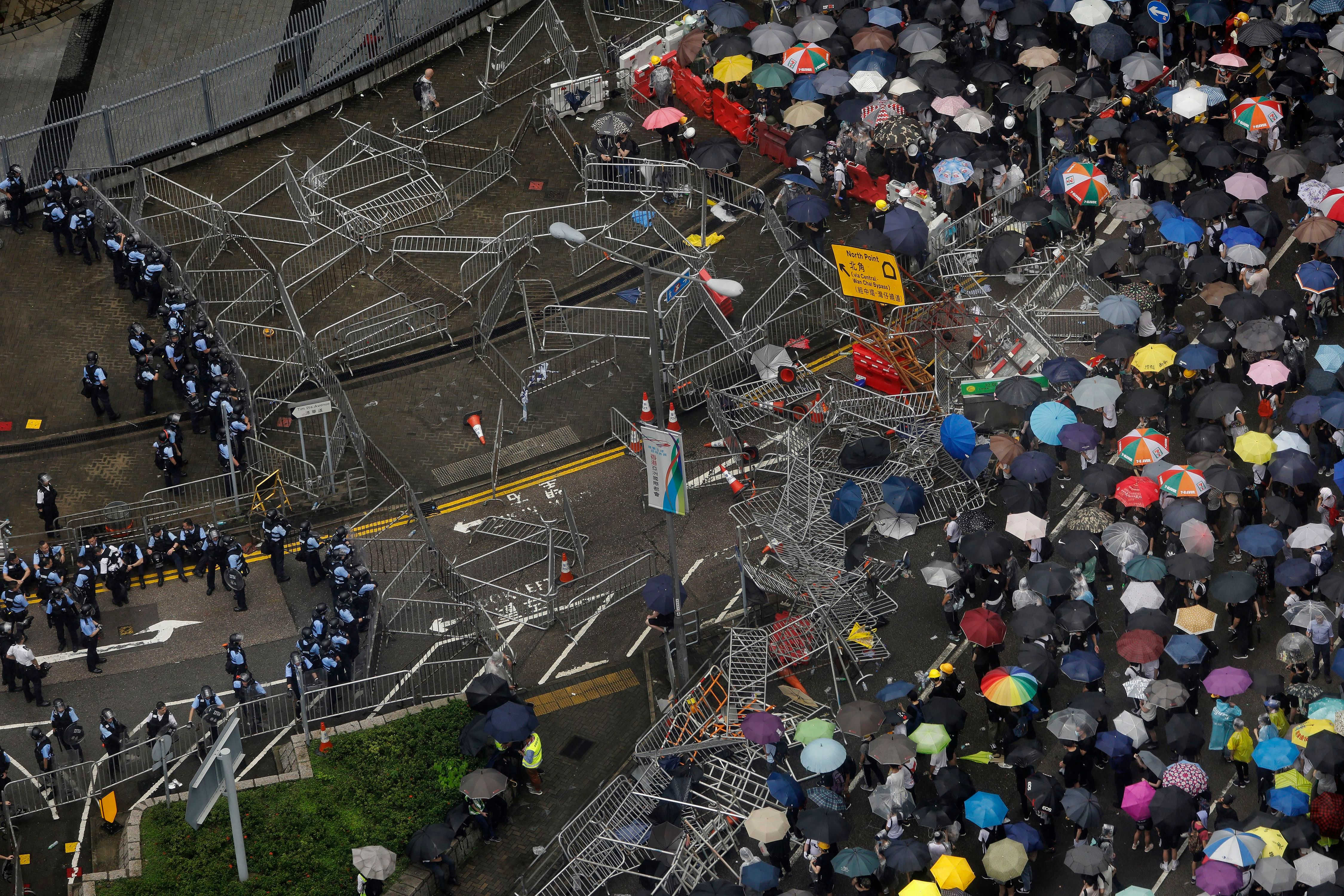 Protesters braved the rain and built barricades, facing off against police.