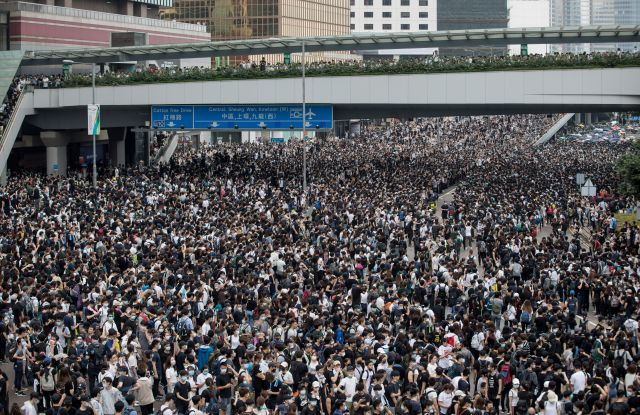 Protesters take part in a rally against an extradition bill outside the Legislative Council in Hong Kong, China, 12 June 2019. The bill, scheduled for a second reading on 12 June has faced immense opposition from pan-democrats, the business sector, and the international community, would allow the transfer of fugitives to jurisdictions which Hong Kong does not have a treaty with, including mainland China. Critics of the bill have expressed concern over unfair trials and a lack of human rights protection in mainland China.Demonstrators gather to show opposition to amendments to extradition law in Hong Kong, China - 12 Jun 2019